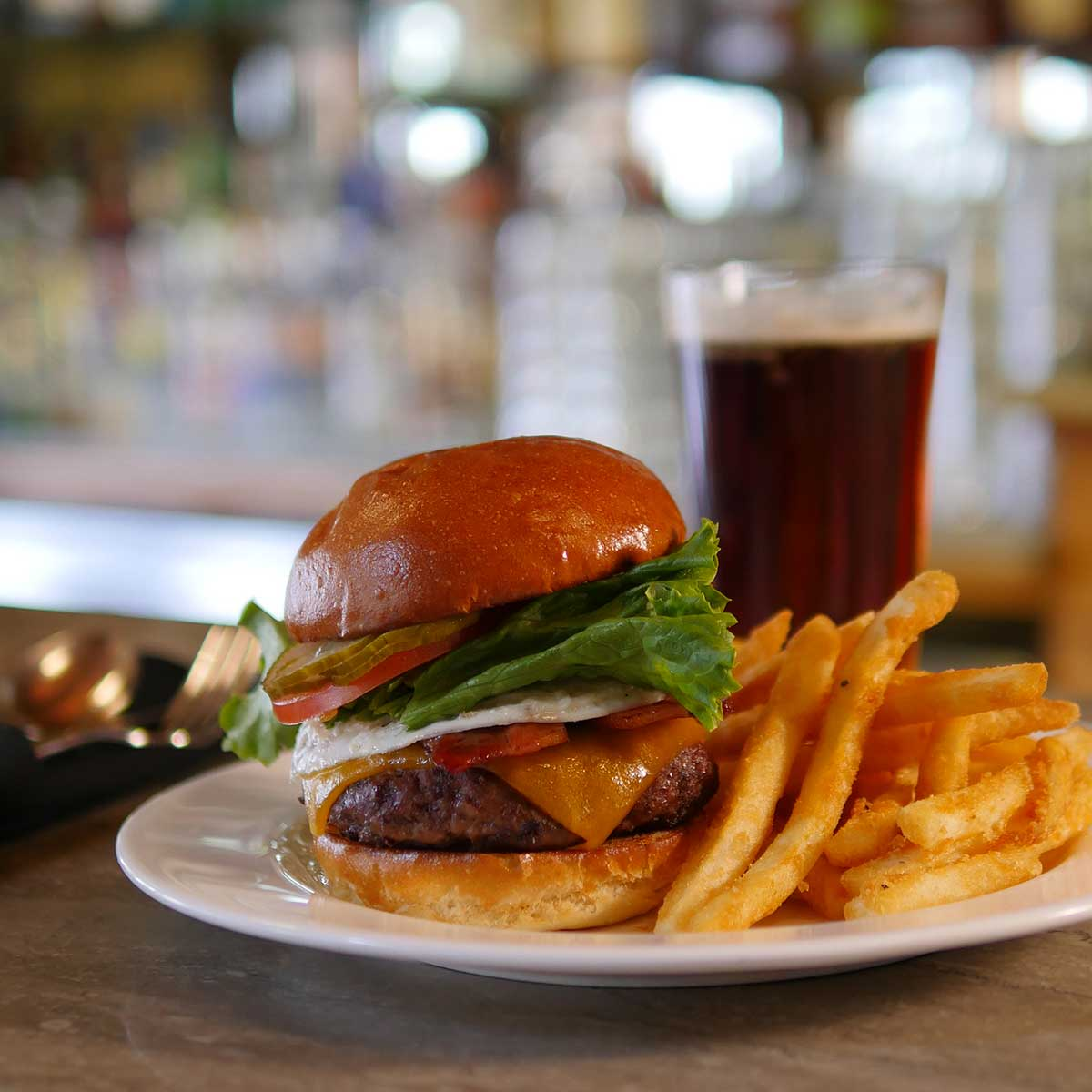 Timbers burger with fries and dark beer